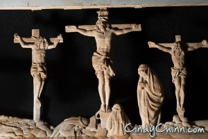 Crucifiction carving on pew