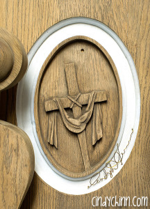 hand carved cross with robe for church pew