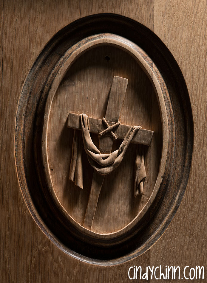 hand carved cross with robe pew