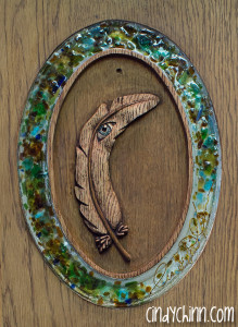 hand carved feather with glass sig