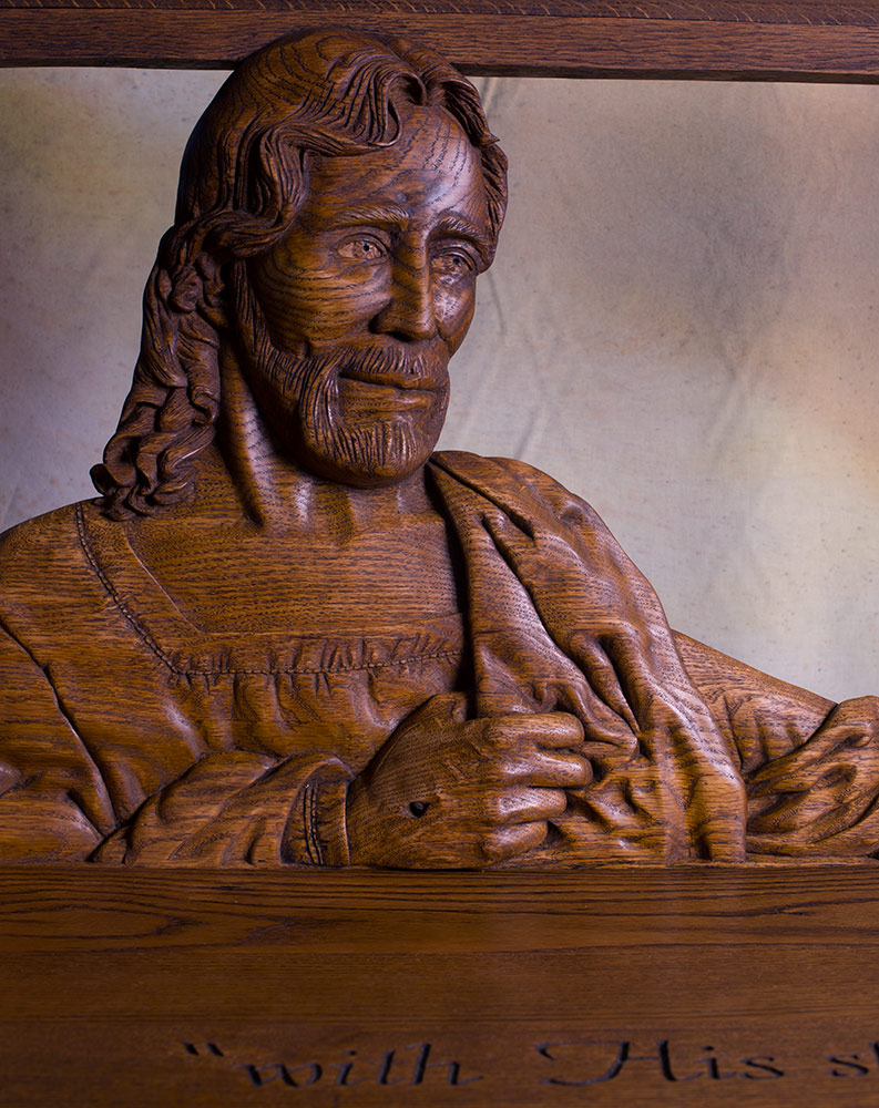 hand carved church pew assembled Christ