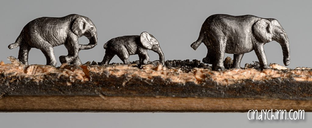 Elephant art - Elephants carved from a carpenter's pencil