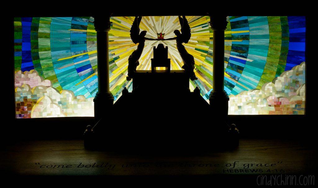Backlit glass mosaic on Church pew