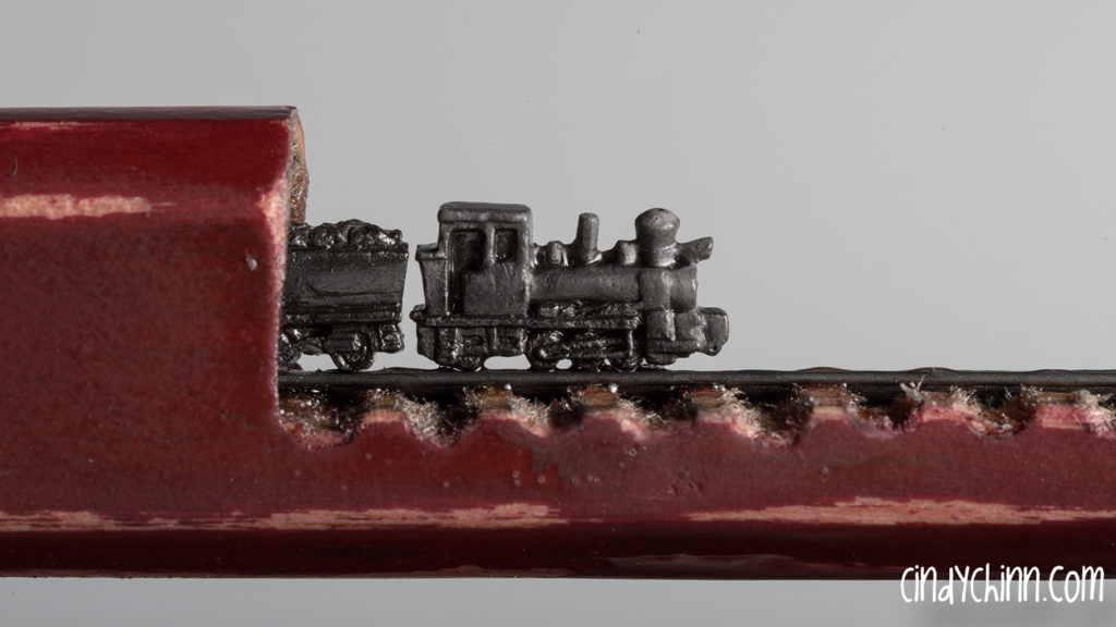 Train carved from a pencil lead by Cindy Chinn - Aggie Express