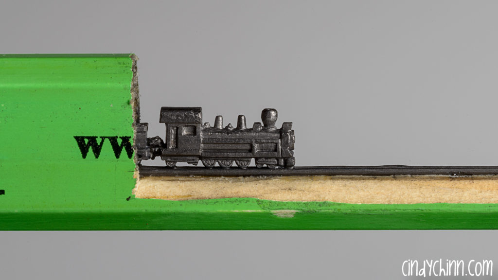 Train carved from a pencil lead by Cindy Chinn - Marvic Express