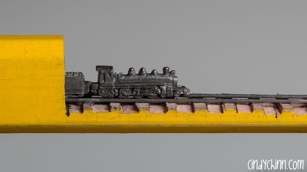 Train carved from a pencil lead by Cindy Chinn - Stanley Steamer