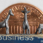 Pencil Carving of a Giraffe Family with Penny