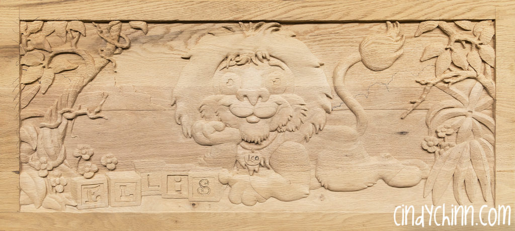carved toy box Leo 11