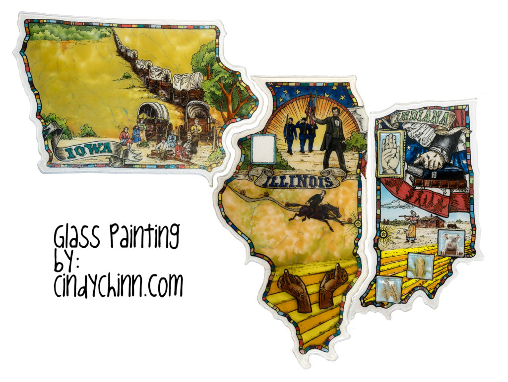 Glass art of Iowa, Illinois and Indiana in various states of completion.